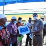 Pemerintah Kabupaten Pangkajene dan Kepulauan, menyalurkan bantuan langsung tunai dan Insentif kepada masyarakat Desa Pitue, di laksanakan di pelataran SD 6 Desa Pitue, Kecamatan Marang, Selasa 11 Mei 2021.(Ist).